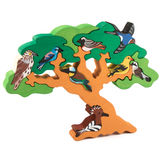 Wooden tree toy with birds Royalty Free Stock Photo