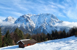 Wooden trekker hut in winter mountains Stock Photography