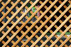 Wooden trellised fence from a pine Royalty Free Stock Photo