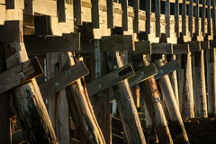 Wooden trestle bridge in sunlight Royalty Free Stock Photos