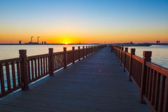 The wooden trestle on the lake sunset Royalty Free Stock Photo