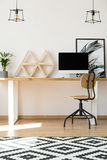 Wooden triangle shelves on desk Stock Image