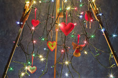 The wooden tripod, easel decorated with Christmas lights and han Royalty Free Stock Image
