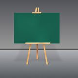 Wooden tripod with a green chalkboard Stock Images