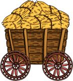 Wooden trolley full with bale of hay Stock Images