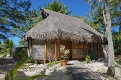 Wooden tropical bungalow with thatched roof Stock Photo