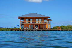 Wooden tropical home over water of Caribbean sea Royalty Free Stock Images