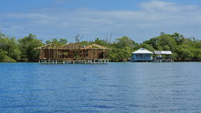 Wooden tropical house construction over the sea Royalty Free Stock Images