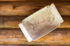 Wooden trough hangs. On the wall Stock Images