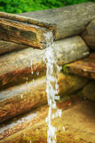 Wooden trough on holy spring Stock Photography