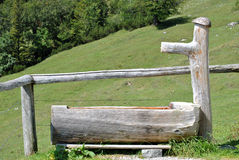 Wooden trough in the mountains Royalty Free Stock Images