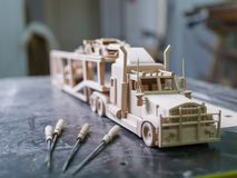 A wooden truck made on a special machine stock photos