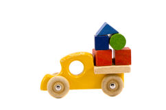 Wooden truck toy with colorful blocks Stock Image