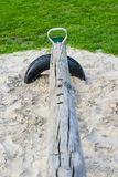 Detail of wooden seesaw in sand royalty free stock images