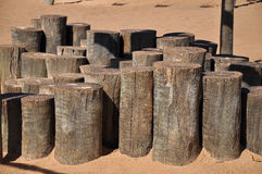 Wooden trunks nailed in the sand Royalty Free Stock Photography