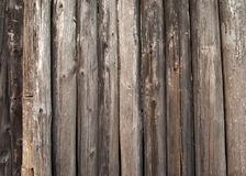 Wooden trunks stockade fence of wood close-up background Stock Images