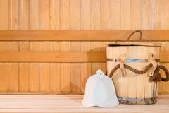 Wooden tub and a woolen cap in the sauna Royalty Free Stock Image