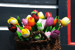 Wooden tulips. Colorful Wooden Tulips in a wooden basket in front of an old house , netherlands Stock Photo
