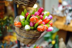 Wooden tulips and decorations sold on Easter market in Vilnius. Annual spring fair hold in March on the streets of capital of Lithuania Royalty Free Stock Photo