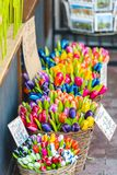Wooden tulips for sale on an Amsterdam market. Dutch souvenirs - wooden tulips for sale on an Amsterdam market Royalty Free Stock Photo