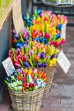 Wooden tulips for sale on an Amsterdam market. Dutch souvenirs - wooden tulips for sale on an Amsterdam market Stock Image