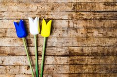Wooden tulips on a table with copy space. Top view Royalty Free Stock Photo