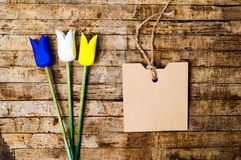 Wooden tulips on a table with copy space. Top view Stock Photography