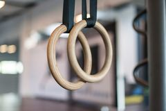 Wooden turn rings in fitness hall royalty free stock images