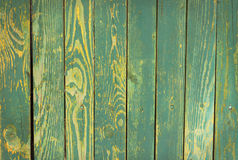 Wooden turquoise texture. Wood blue fence  texture with yellow spots Royalty Free Stock Photos