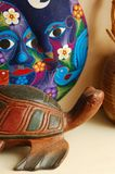 Wooden Turtle. A wooden turtle and mask.  Souvenirs Royalty Free Stock Photo