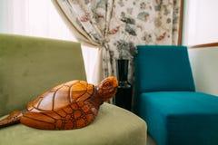 Wooden turtle. Elements of interior design Stock Photos