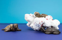 Wooden turtle figurines. With coral on blue background Royalty Free Stock Photography
