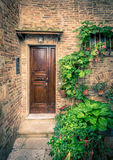 Wooden tuscan doors. Vintage brown doors somewhere in Tuscany, Italy Royalty Free Stock Photos