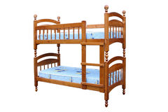 Wooden two-storeyed bed. Separately on a white background Stock Images
