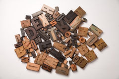 Wooden typescript letters on white Stock Image