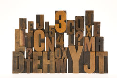 Wooden typeset  letters. Old wood typeset letters stacked Royalty Free Stock Photography