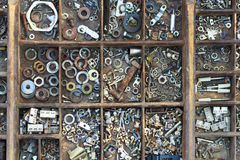 Wooden typesetter case with nuts, bolts, washers Stock Image