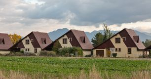 Wooden typical cottages in a row stock image