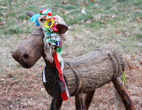 Wooden Ukrainian bull-calf in a flower wreath. Royalty Free Stock Photography