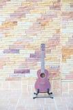 Wooden ukulele  at home Royalty Free Stock Image