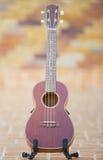 Wooden ukulele  at home Stock Image