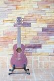 Wooden ukulele  at home Stock Photo