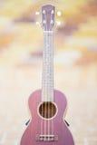 Wooden ukulele isolated at home Stock Photo