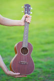 Wooden ukulele isolated at home Royalty Free Stock Photography