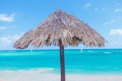 Wooden umbrella on beach Stock Photography
