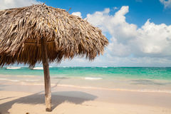 Wooden umbrella on beach in Dominican republic Stock Photography
