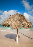 Wooden umbrella on the beach in Dominican republic Stock Image