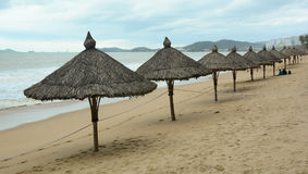 Wooden umbrella on the beach in Nha Trang, Vietnam Royalty Free Stock Photography