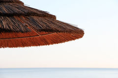 Wooden umbrella on the beach, space for text Royalty Free Stock Photo