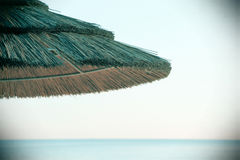 Wooden umbrella on the beach, vintage Royalty Free Stock Photo